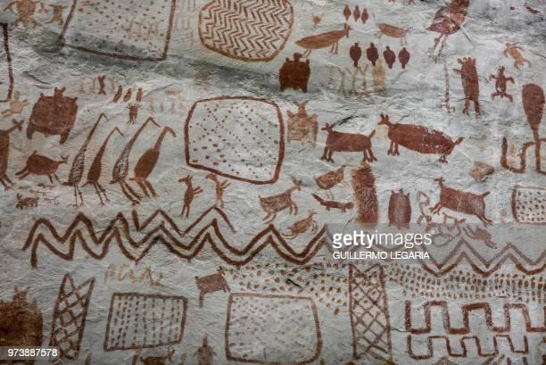 View of rock art at the Cerro Azul hill in Serrania La Lindosa in the Amazonian jungle department of Guaviare, Colombia, on June 8, 2018. - The...