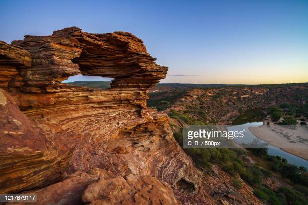 view of rock formation and river , kalbarri, australia - felsformation stock-fotos und bilder