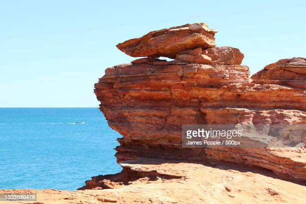 view of rock formation in sea against clear sky,minyirr,western australia,australia - james popple stock pictures, royalty-free photos & images