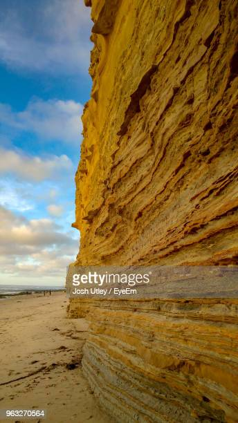 view of rock formations on beach - josh utley stock pictures, royalty-free photos & images