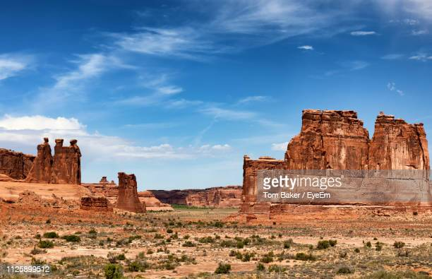 view of rock formations on landscape against sky - utah stock pictures, royalty-free photos & images