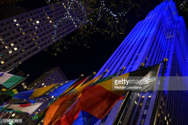 View of Rockefeller Center lit in blue on April 16, 2020 in New York City. Landmarks and buildings across the nation are displaying blue lights to...