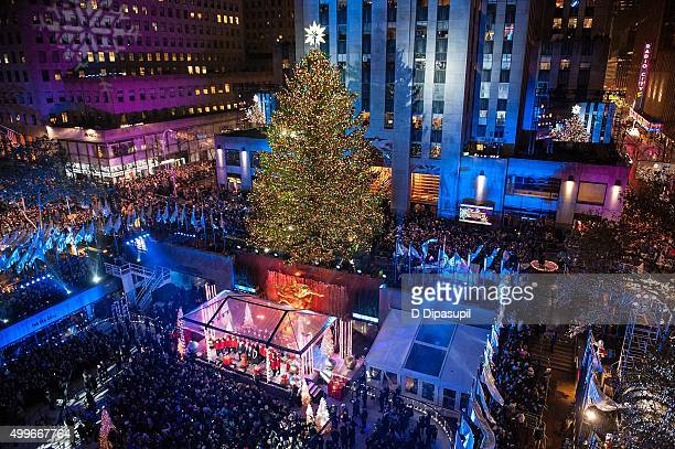 A view of Rockefeller Center Tree moments after lighting during the 83rd Rockefeller  Center Tree Lighting - Rockefeller Center Christmas Tree Stock Photos And Pictures |