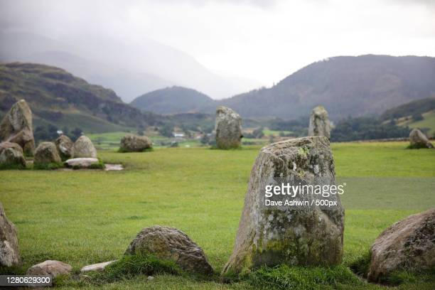 view of rocks on field against sky,castle ln,keswick ca rn,united kingdom,uk - dave ashwin stock pictures, royalty-free photos & images