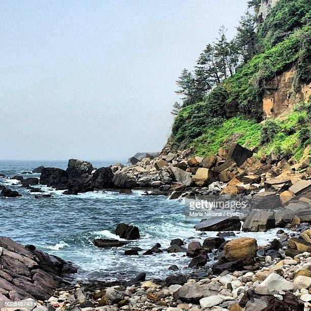 view of rocky beach - nikitina stock pictures, royalty-free photos & images