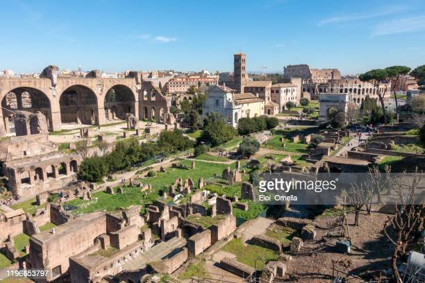 view of roman forum during the day in rome. italy - arch of septimus severus stock pictures, royalty-free photos & images
