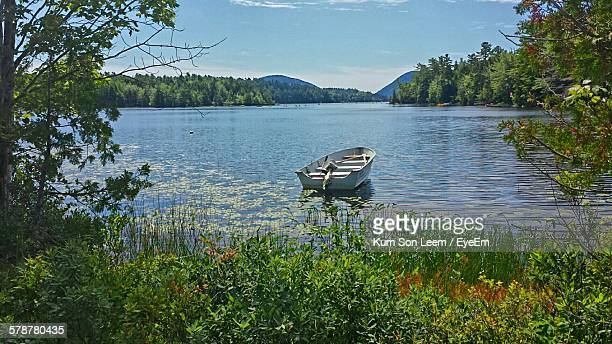 view of rowboat on lake - pocono mountains stock pictures, royalty-free photos & images