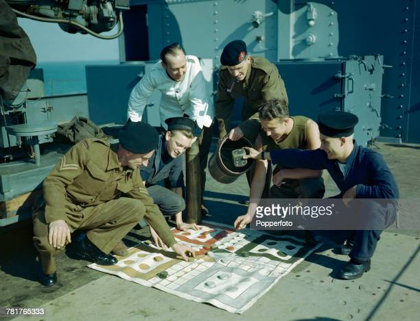 View of Royal Marines and sailors playing a game similar to Ludo on the deck of a Maunsell Sea Fort during World War 2 in October 1944 The Sea Forts...