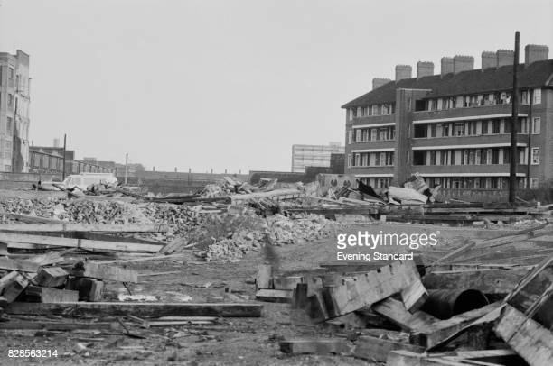 View of rubble and housing near St Katherine Docks, London, 30th January 1975.