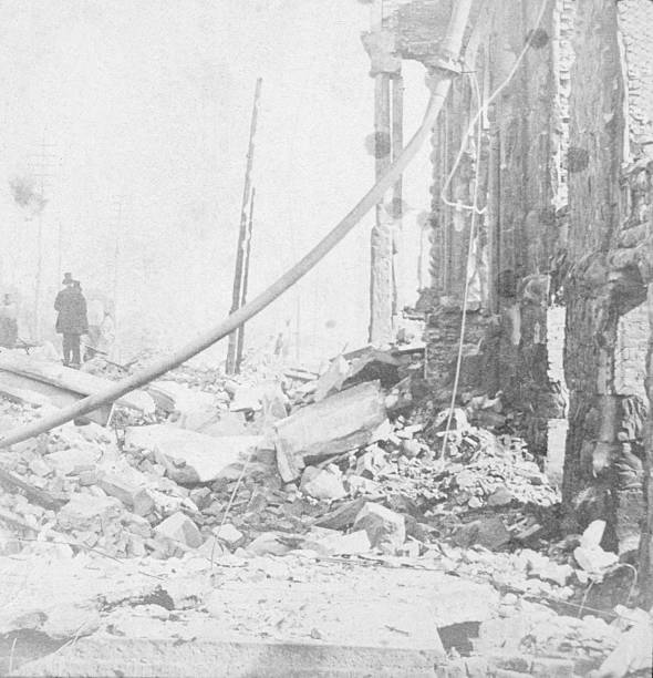 View of rubble and wreckage in Washington Street, East...