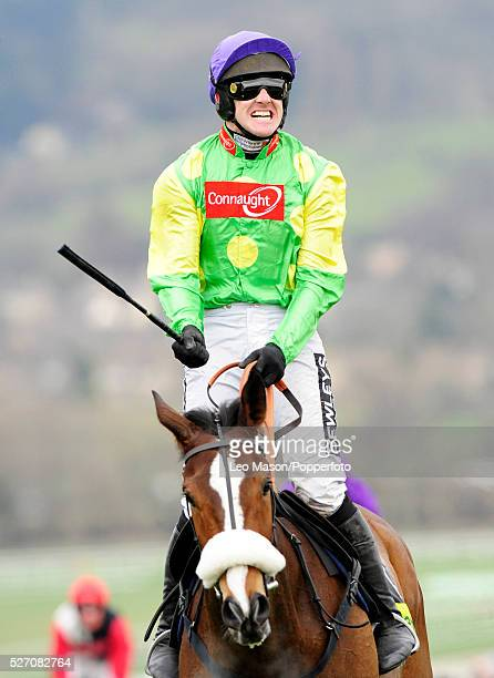 View of Ruby Walsh and Kauto Star celebrating after winning the Totesport Cheltenham Gold Cup Chase during the 2009 Cheltenham Festival at Cheltenham...