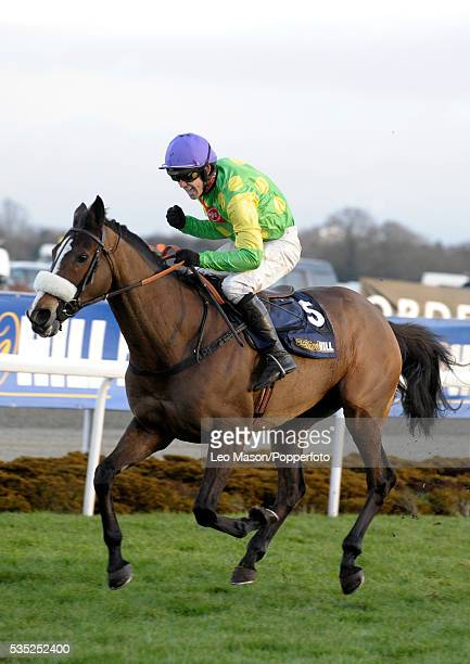 View of Ruby Walsh and Kauto Star on their way to an historic jump racing 4th consecutive win by a record 36 lengths in the William Hill King George...