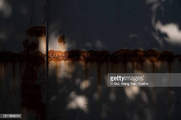 view of rust on wall in dark room - kawagoe stock pictures, royalty-free photos & images