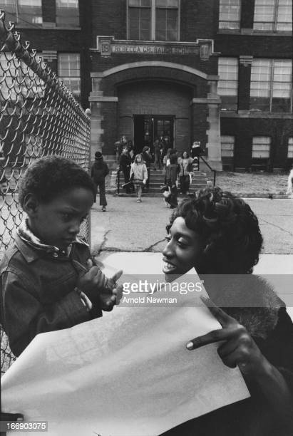 View of Ruthie Scott as she speaks with her son outside a school Mansfield Ohio 1976