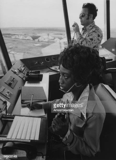 View of Ruthie Scott at work in an airport control tower Mansfield Ohio 1976