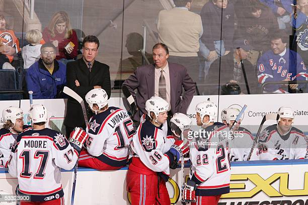 View of Ryan McGill and Nick Fotiu repectively the head coach and assistant coach of the Hartford Wolf Pack behind the bench during a game against...