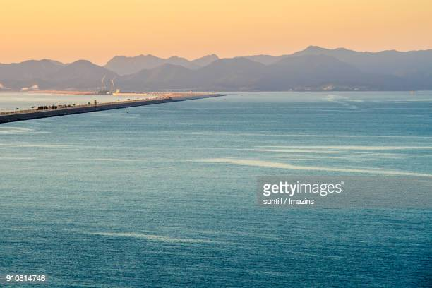view of saemangeum seawall - seawall stock pictures, royalty-free photos & images