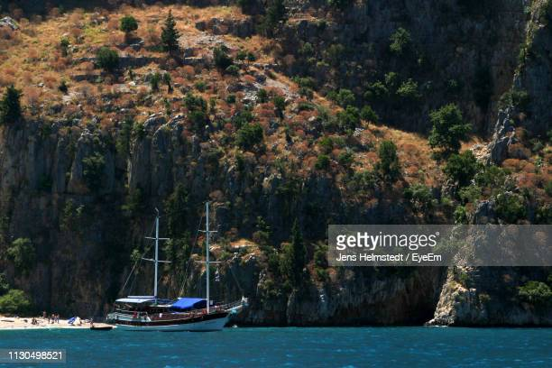 view of sailboat on sea - jens helmstedt stock-fotos und bilder