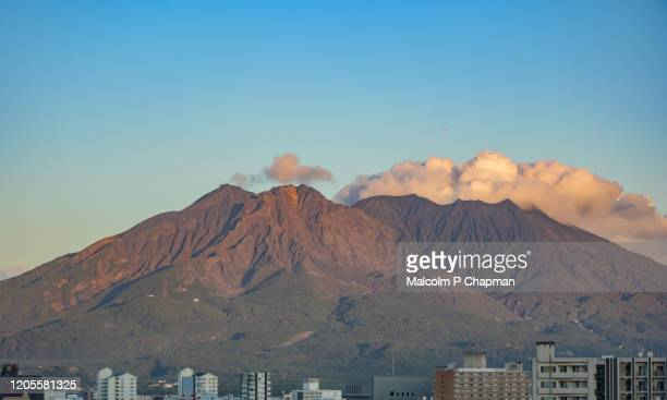 view of sakurajima (sakura-jima) volcano at sunset seen from kagoshima, kyushu, japan - 鹿児島県 ストックフォトと画像