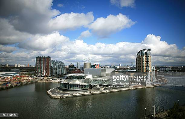 A view of Salford Quays in Greater Manchester England showing the Lowry Centre and the Millennium Lifting Footbridge on March 27 The regeneration of...
