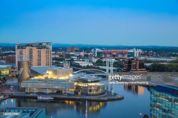 view of salford quays looking towards the lowry theatre and old trafford, manchester, england, united kingdom, europe - サルフォードキー ストックフォトと画像