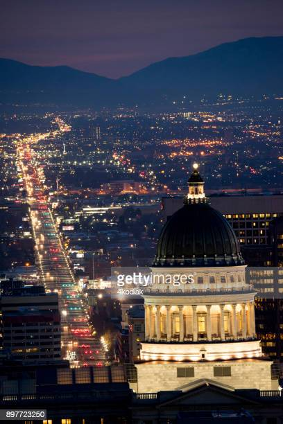 view of salt lake city at dawn - park city utah stock photos and pictures