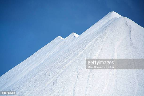 view of salt mountain against clear sky - sodium stock photos and pictures