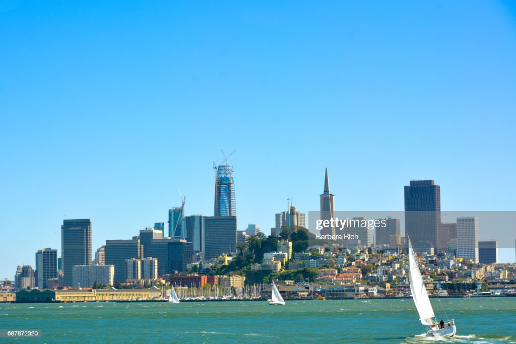 View of San Francisco and the skyline from across the San Francisco Bay with sailboats in the foreground : Stock Photo