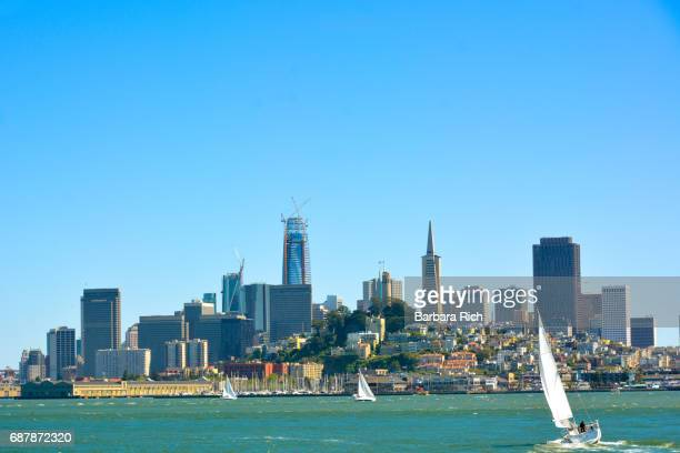 View of San Francisco and the skyline from across the San Francisco Bay with sailboats in the foreground