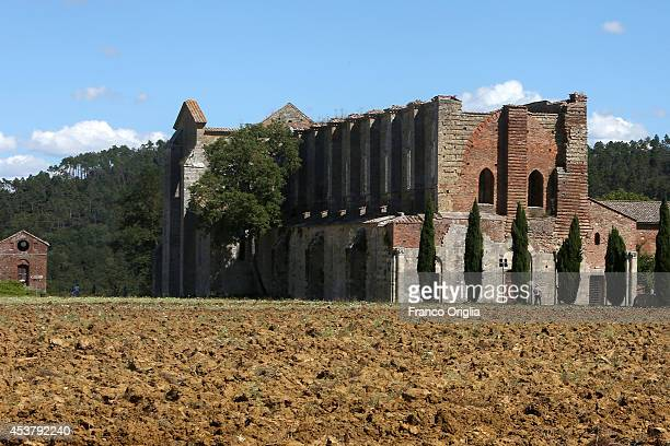 A view of San Galgano Abbey on August 18 2014 in San Galgano Siena Italy The Gothic abbey of San Galgano now ruined was built to honor St Galgano a...