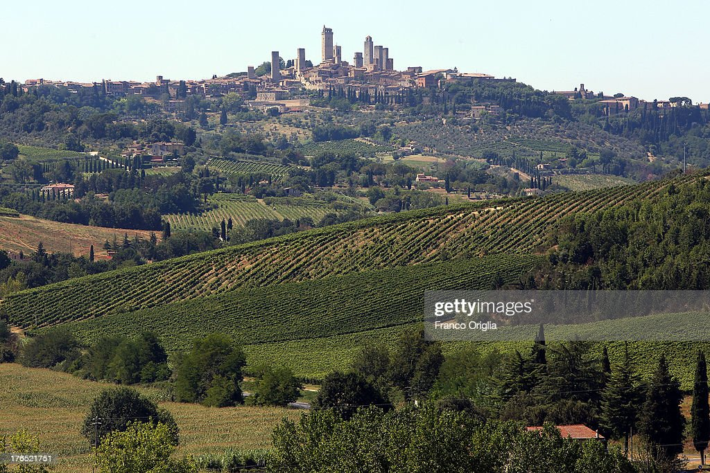 A view of San Gimignano on August 14, 2013 in San Gimignano, Italy. San Gimignano is a small walled medieval hill town in the province of Siena, Tuscany. Known as the Town of Fine Towers, San Gimignano is famous for its medieval architecture, unique in the preservation of about a dozen of its tower houses.