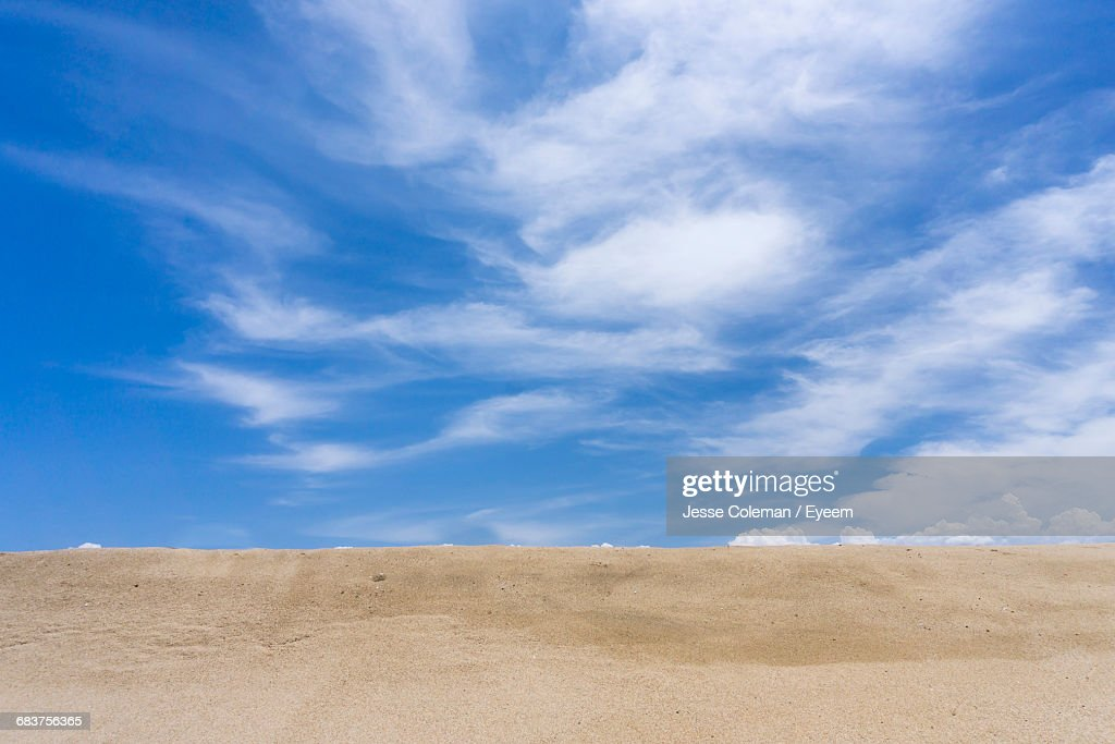View Of Sand Against Blue Sky And Clouds : Stock Photo
