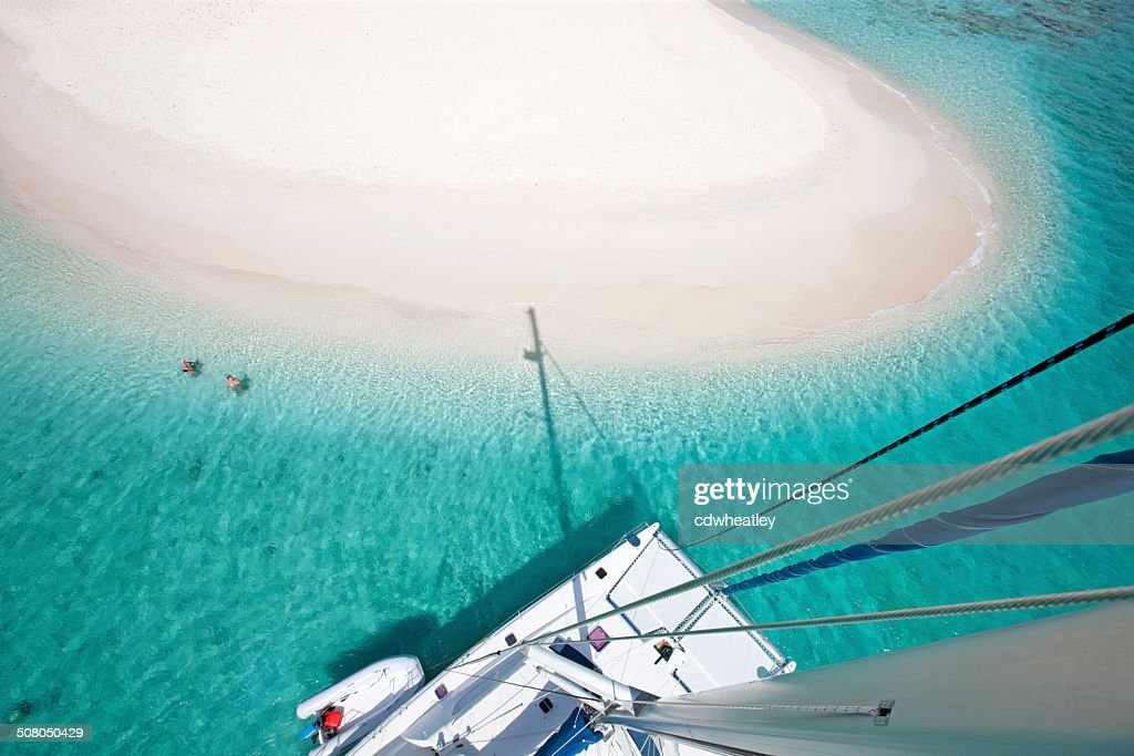 view of Sandy Spit, BVI from the catamaran's mast : Stock Photo