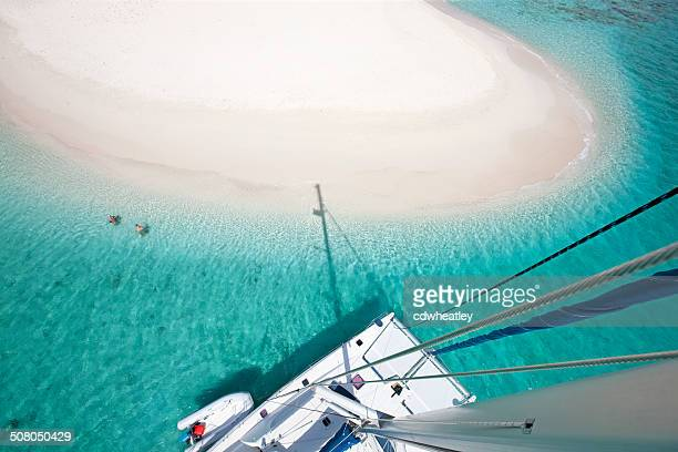 view of sandy spit, bvi from the catamaran's mast - catamaran stock photos and pictures