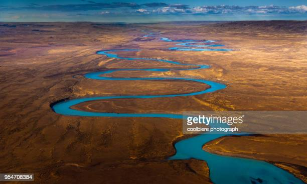 view of santa cruz river from the airplane - patagonia foto e immagini stock