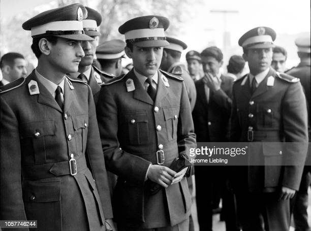 View of Saudi Prince Bandar AlFaisal along with unidentified others all in military Officer Cadet uniforms as they stand outside the Tate Museum...