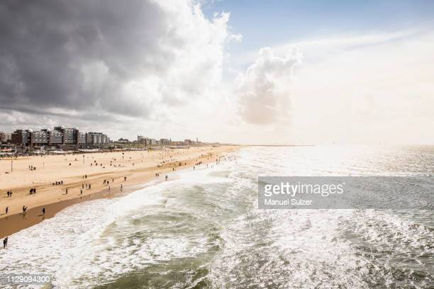 view of scheveningen coast and beach from pier, south holland, netherlands - scheveningen stock pictures, royalty-free photos & images
