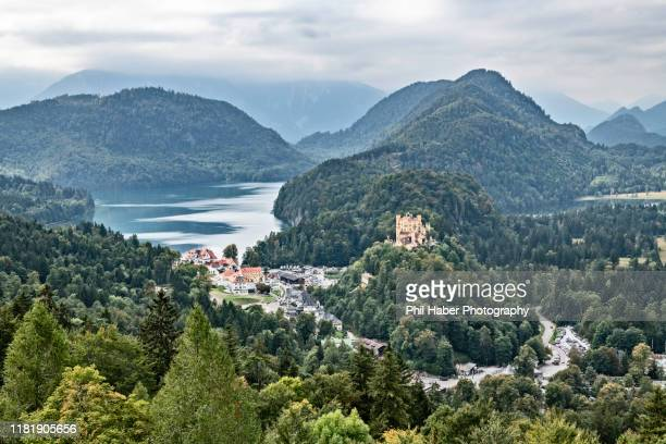view of schwangau on a foggy day - phil haber stock pictures, royalty-free photos & images