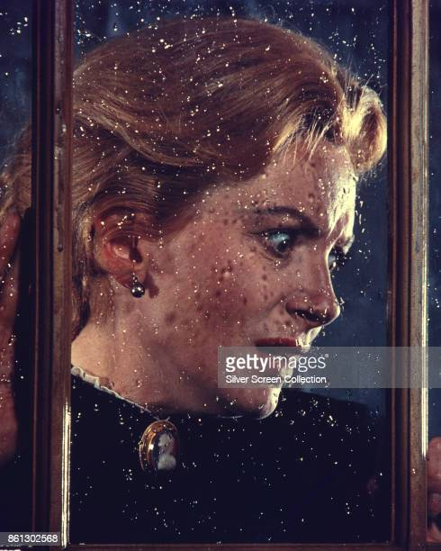 View of Scottish actress Deborah Kerr behind a rain-splattered window in a scene from 'The Innocents' , England, 1961.