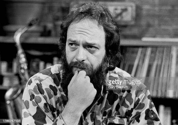 View of Scottish Rock musician Ian Anderson, of the group Jethro Tull, his hand on his chin during an interview at MTV Studios, New York, New York,...