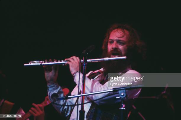View of Scottishborn British Folk Rock and Blues musician Ian Anderson as he plays flute onstage with the group Jethro Tull during a performance 1978...