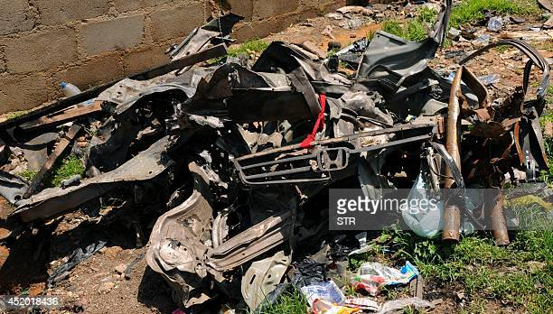 A view of scrap metal and debris from vehicles used in May 20 2014 twin car bombings carried out by Islamist Boko Haram insurgents near the Terminus...