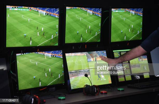 View of screens at the Video Operator Room of the Conmebol headquarters in Luque, Paraguay, on September 25, 2019. - The use of VAR in football...