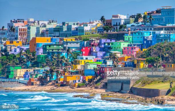 view of sea against buildings in city - puerto rico stock pictures, royalty-free photos & images