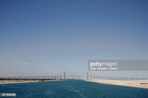 view of sea against clear blue sky - suez canal stock photos and pictures