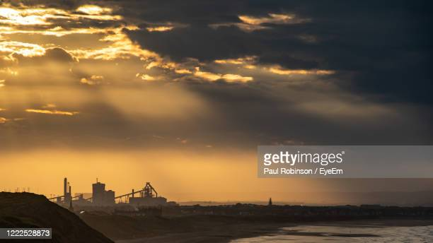 view of sea against cloudy sky during sunset - saltburn stock pictures, royalty-free photos & images