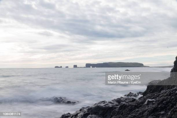 view of sea against cloudy sky - punalu'u_beach stock pictures, royalty-free photos & images
