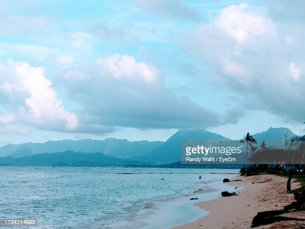 view of sea against cloudy sky - honolulu stock pictures, royalty-free photos & images