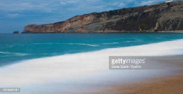 view of sea against cloudy sky - nazar stock photos and pictures