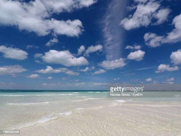 view of sea against cloudy sky - isla mujeres stock photos and pictures